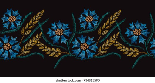 Elegant seamless pattern with hand drawn decorative cornflowers and wheat, design elements. Floral pattern for invitations, cards, wallpapers, print, gift wrap, manufacturing, fabrics.Embroidery style
