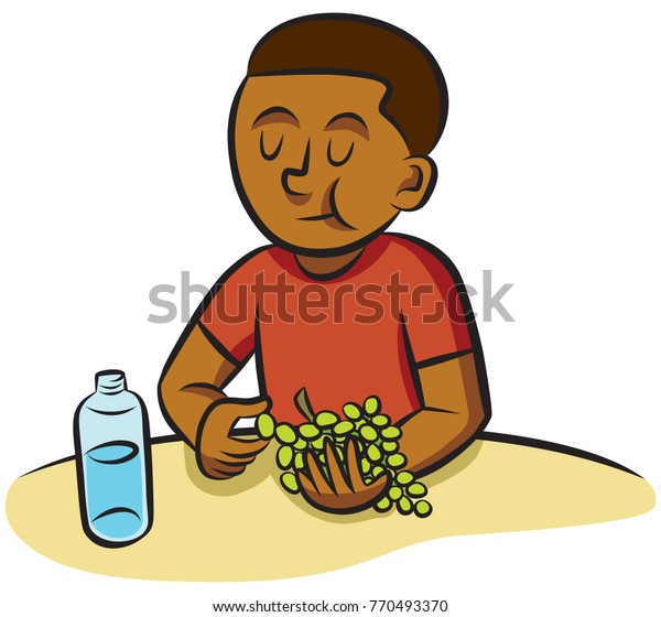 Elementary-school age boy eating grapes at snack time.