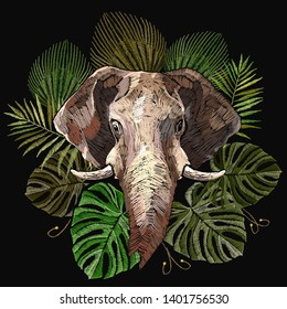 Elephant head and palm leaves. Embroidery indian jungle style. Wildlife art. Template for clothes, textiles, t-shirt design