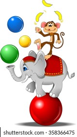 elephant and monkey juggling the ball at the circus