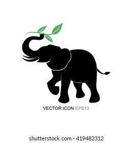 Elephant symbol.Vector illustration. elephant picture tea and sprigs. Silhouette of an elephant. Logo for tea. Flat icon.