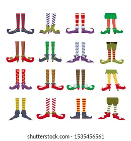 Elf feet flat cartoon colourful vector illustrations. Leprechaun shoes and stripped socks icons set. Christmas dwarf leg in funny boots isolated on white background. Festive christmas gnome bundle
