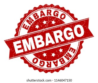 EMBARGO seal print with distress style. Rubber seal imitation has round medallion form and contains ribbon. Red vector rubber print of EMBARGO text with dirty texture.