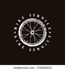 Emblem for bicycle club. Graphic design for t-shirt. White print on black background