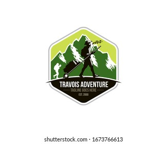emblem logo of sherpa trekker pulling travois walking on the ground in front of mountains