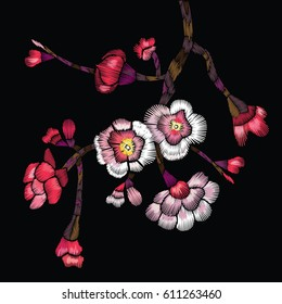 Embroidered blooming branch. Cherry branch, apple or sakura with flowers and buds on a black background. Vector illustration for embroidery, patches and stickers