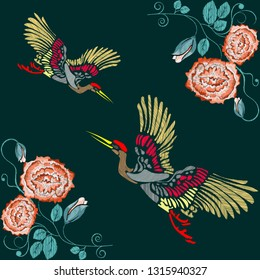 Embroidered folk ornament of orange roses, crane and other wildflowers. Vector illustration.