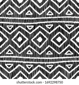 Embroidered geometric pattern. Black patches on a white background. Handmade ornament. Embroidery, fancywork, sewing, hobby. Vector illustration.