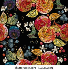 Embroidery apples and plums, berries, cowberry seamless pattern. Fashion nature template for clothes, textiles, t-shirt design. Classical embroidery ripe apples on branch, juicy plums and berries