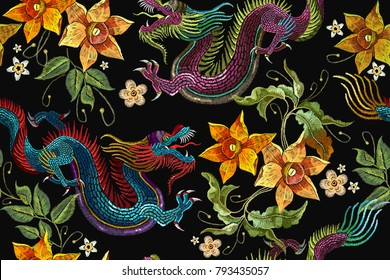 Embroidery Asian dragon and beautiful flowers seamless pattern. China dragons vector