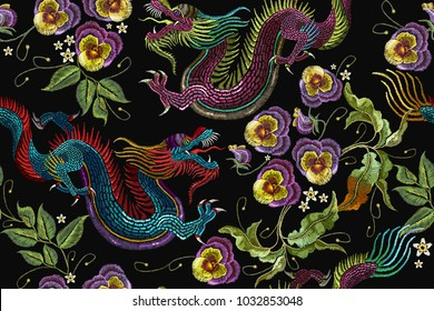 Embroidery asian dragons and beautiful flowers seamless pattern. Clothes, textile design template