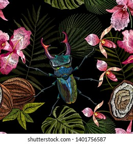 Embroidery beetle deer, palm leaves and orchid flowers seamless pattern. Jungle art.  Summer tropical template for clothes, textiles, t-shirt design