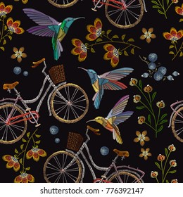 Embroidery bicycle, flowers and humming birds seamless pattern. Fashionable summer pattern embroidery bicycle humming bird and flowers art, template clothes