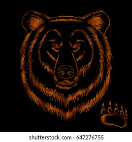 Embroidery brown bear head isolated on black background. Template for clothing patch.