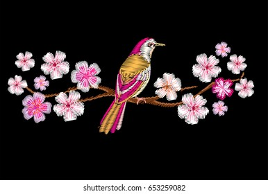 Embroidery cherry or sakura branch blossom and bird.