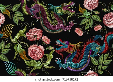 Embroidery chinese dragons and flowers peonies seamless pattern. Classical embroidery asian dragons and beautiful peonies seamless pattern. Art dragons t-shirt design. Clothes, textile design template