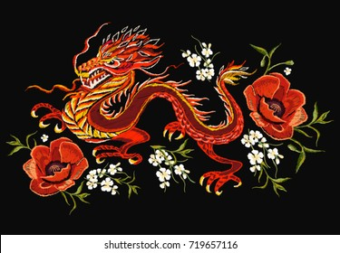 Embroidery colorful floral  pattern with chinese, japanese dragon.  Vector traditional folk fashion ornament on black background. An Asian dragon.