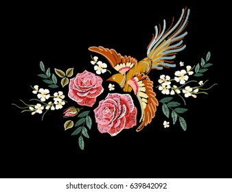 Embroidery colorful floral pattern with flowers, japanese bird. Vector traditional folk fashion ornament on black background.