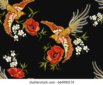 Embroidery colorful floral pattern with flowers, japanese bird. Vector traditional folk fashion ornament on black background. Perfect for your textile design.