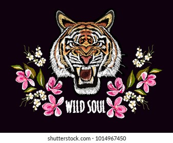 Embroidery colorful floral pattern with  japanese flowers, sakura, tiger. Vector traditional folk fashion ornament on black background.
