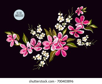 Embroidery colorful floral pattern with  japanese flowers, sakura. Vector traditional folk fashion ornament on black background.