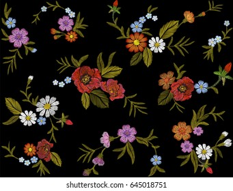 Embroidery colorful floral pattern with red roses and forget me not flowers. Vector traditional folk fashion ornament on black seamless background.