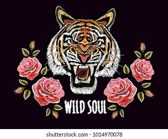 Embroidery colorful floral pattern with roses,  tiger. Vector traditional folk fashion ornament on black background.