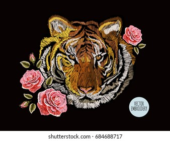 Embroidery colorful floral pattern with roses, japanese tiger. Vector traditional folk fashion ornament on black background.