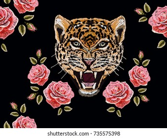 Embroidery colorful floral seamless pattern with roses, leopard. Vector traditional folk fashion ornament on black background.