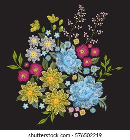 Embroidery colorful trend floral pattern. Vector traditional folk blue roses, chamomile, forget me not flowers bouquet on black background for clothing design.