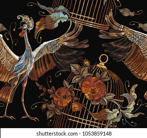 Embroidery crane birds, golden cage and roses seamless pattern. Classical embroidery two Japanese cranes, gold cage and red buds of roses art pattern. Template for clothes, textiles, t-shirt design
