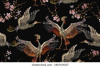 Embroidery crane birds and sakura flowers seamless pattern. Asian template for clothes, textiles, t-shirt design. Japanese art