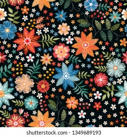 Embroidery ditsy seamless pattern with colorful wild flowers on black background.