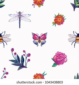 Embroidery dragonfly, tropical butterfly, funny bee, marigolds, peony flower, berry branch, insects patch. Fashion patches with summer wild nature illustration embroideries. Seamless pattern backdrop.