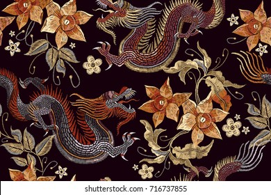 Embroidery dragons and flowers seamless pattern. Classical embroidery Asian dragon and beautiful vintage flowers seamless pattern