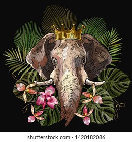 Embroidery elephants heads and tropical flowers. Indian jungle style. Wildlife art. Template for clothes, textiles, t-shirt design