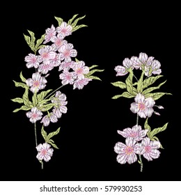 Embroidery. Embroidered design elements with sakura flowers and leaves in vintage style on a black background. Stock vector illustration.