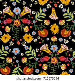 Embroidery ethnic seamless pattern with colorful flowers. Vector traditional floral bouquet. Tribal style design for fashion wearing