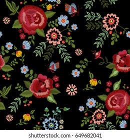 Embroidery ethnic seamless pattern with roses and fantasy flowers. Vector embroidered traditional floral design for fashion fabric