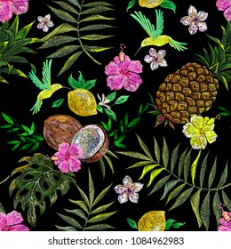 Embroidery exotic floral pattern with hummingbird and tropical flower and coconut. Vector seamless embroidered template for fashion design.