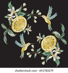 Embroidery fashion pattern with hummingbird and lemon flowers. Vector embroidered floral ornament with bird on black background for clothing design.
