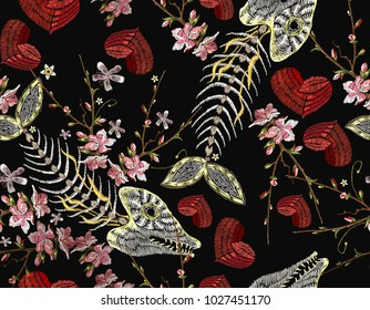 Embroidery fish bone, flowers and heart seamless pattern. Sea pattern embroidery vintage skeleton of fish, cherry flowers and romantic hearts, clothes and t-shirt design. Gothic art pattern