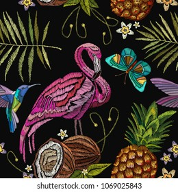 Embroidery flamingo, butterfly palm tree leaves, pineapple, coconut tropical seamless pattern. Fashionable embroidery pink flamingos, tropical summer background. Fashionable template for clothes