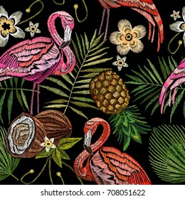 Embroidery flamingo , palm tree leaves, pineapple, coconut tropical seamless pattern. Fashionable embroidery pink flamingos, tropical summer background.  Fashionable template for design of clothes
