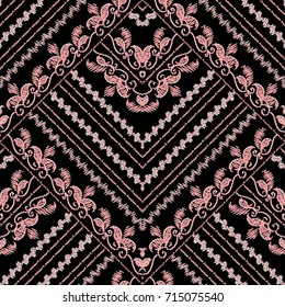 Embroidery floral gold seamless pattern. Black vector background wallpaper with vintage hand drawn embroidered pink flowers, grunge swirl leaves, zigzag stripes and tapestry antique baroque ornaments.