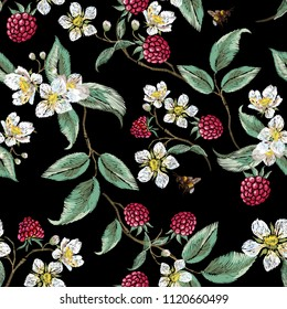 Embroidery floral pattern with aspberries and bee. Vector embroidered patch with flowers for wearing design.