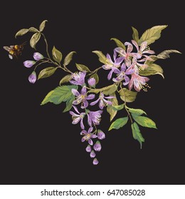 Embroidery floral pattern with lilac blossom and bee. Vector traditional embroidered design with flowers and insect on black background for fashion clothing.