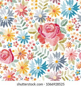 Embroidery floral seamless pattern with different beautiful flowers on white background. Colorful embroidered print with roses, cornflowers and other wildflowers in vector. Fashion design for fabric.