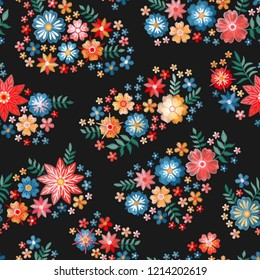 Embroidery flowers. Ditsy seamless pattern with bright embroidered bouquets on black background.