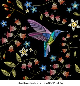 Embroidery flowers and humming birds seamless pattern. Fashionable template for design of clothes. Beautiful chamomiles, cornflowers, tropical birds classical embroidery seamless background